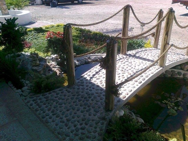 Puente decorado con piedra de rio jardineria xochimilco for Jardineros en xochimilco